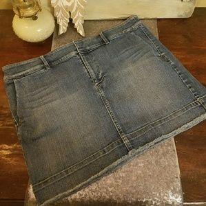 Loft distressed jean mini skirt.